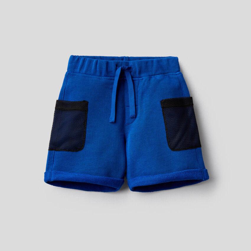 Sweat bermudas with mesh pockets