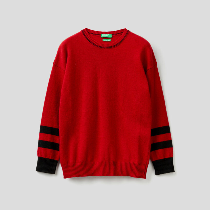 Red sweater with graphic inlay