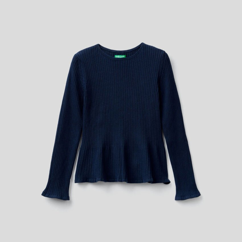 Ribbed knit sweater with flared bottom.