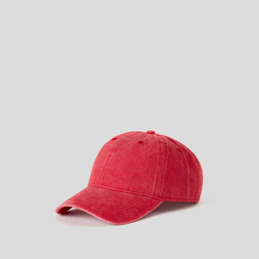 Red baseball cap with washed look