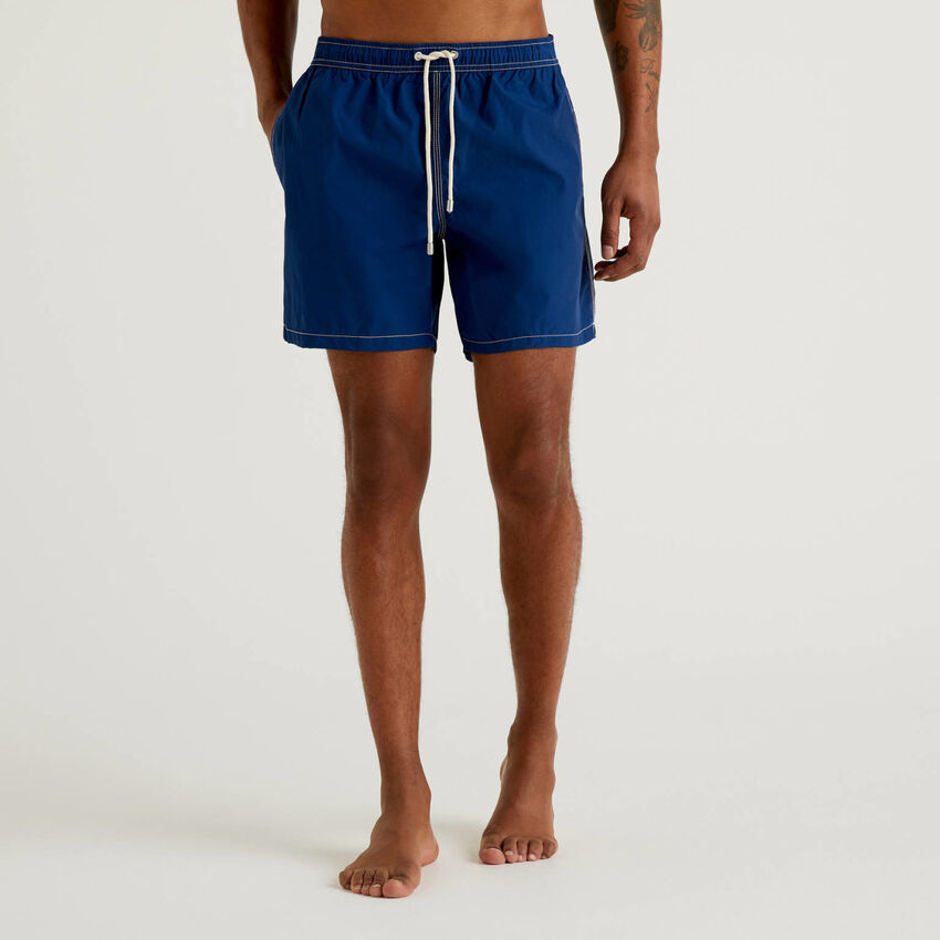 Swim trunks with drawstring and pockets